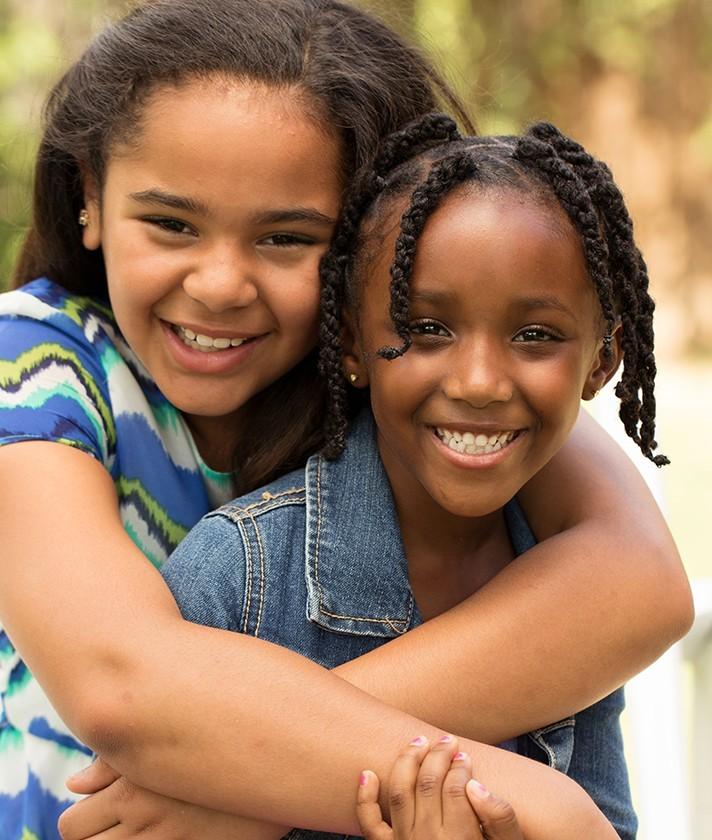 two little girls hug