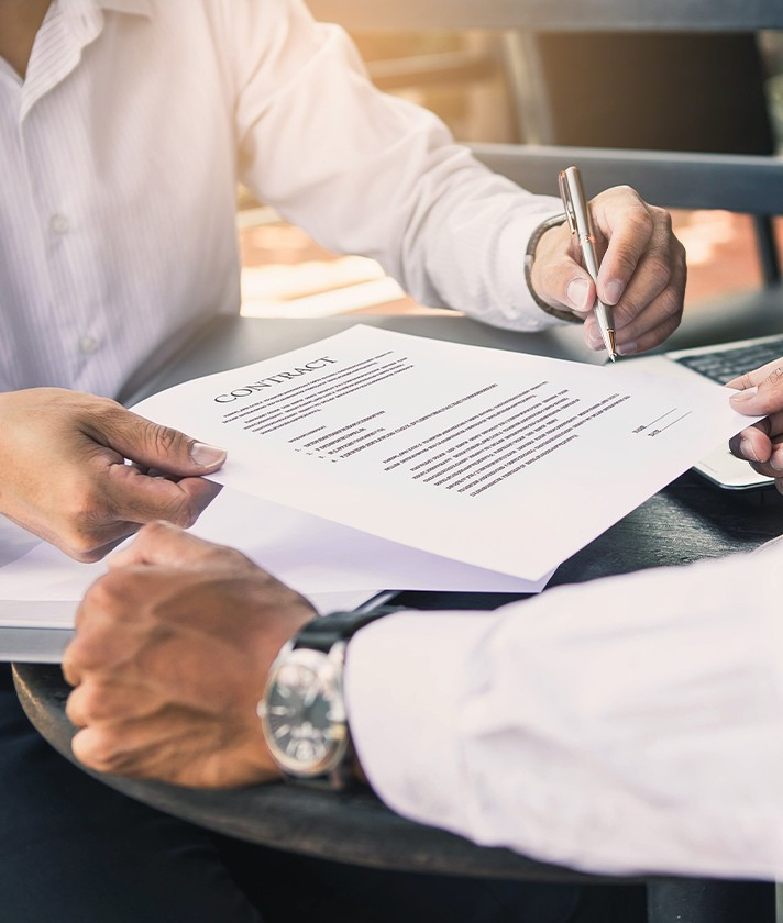 men signing legal contract