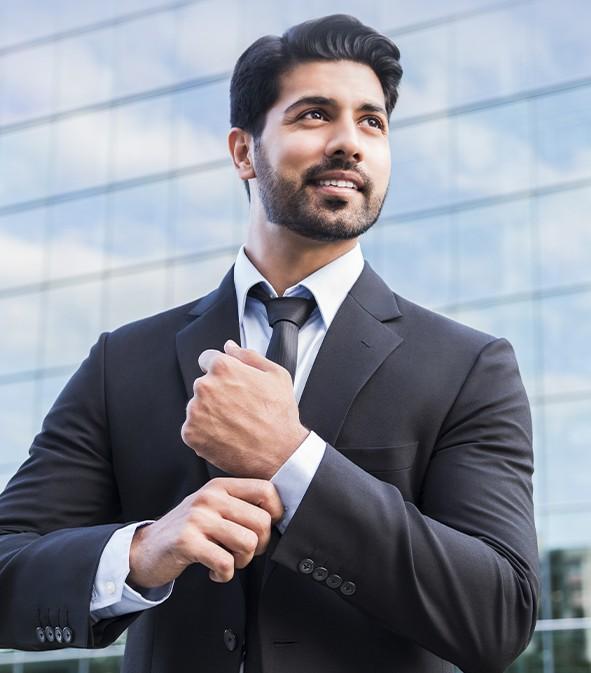 a businessman adjusts his sleeves